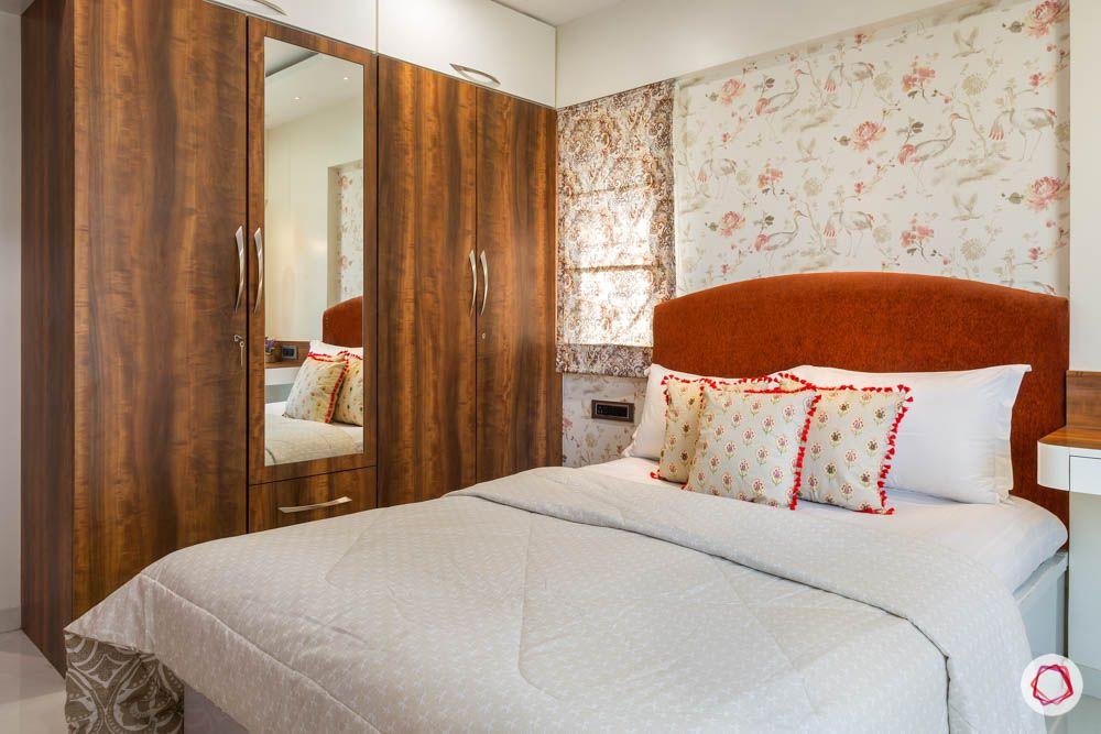 4 bhk flat in mumbai-parents bedroom-laminate wardrobe-lofts-rust orange headboard