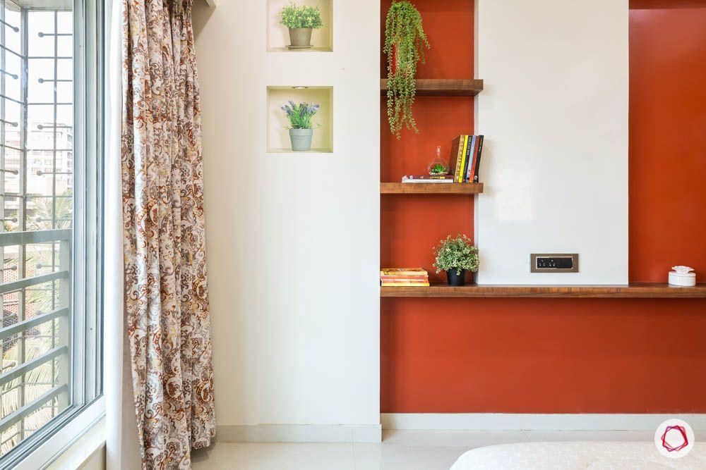 4 bhk flat in mumbai-parents bedroom-tv unit-rust orange wall