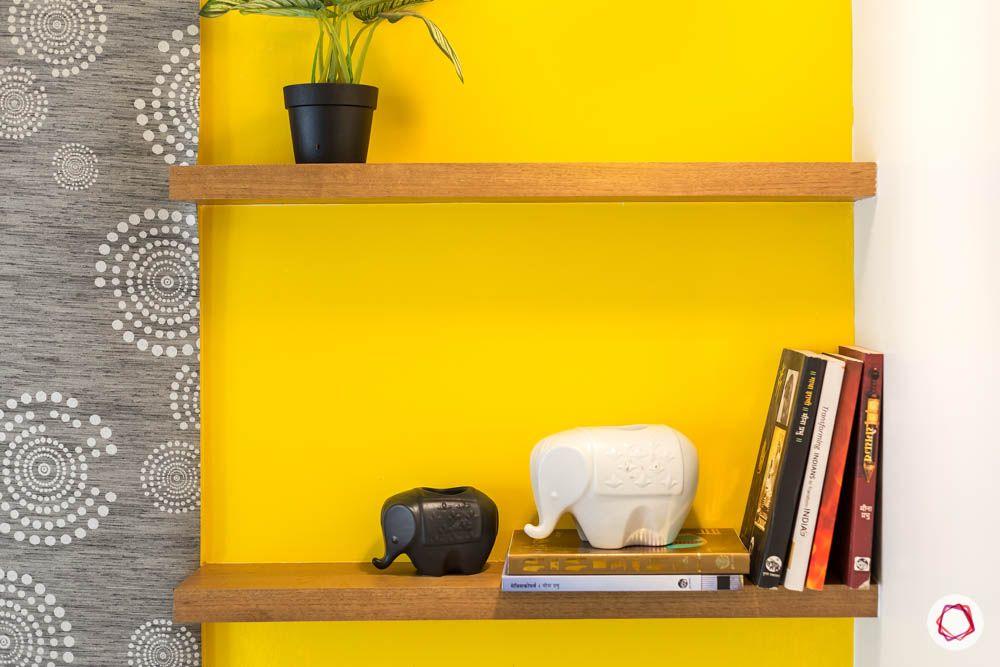 4 bhk flat in mumbai-kids bedroom-yellow wall-display racks