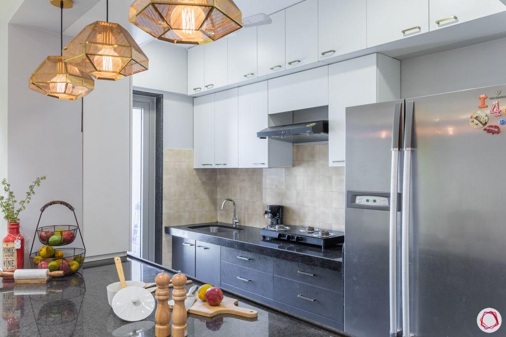 3-bhk-in-mumbai-kitchen-table-top-cabinets-lofts-fridge