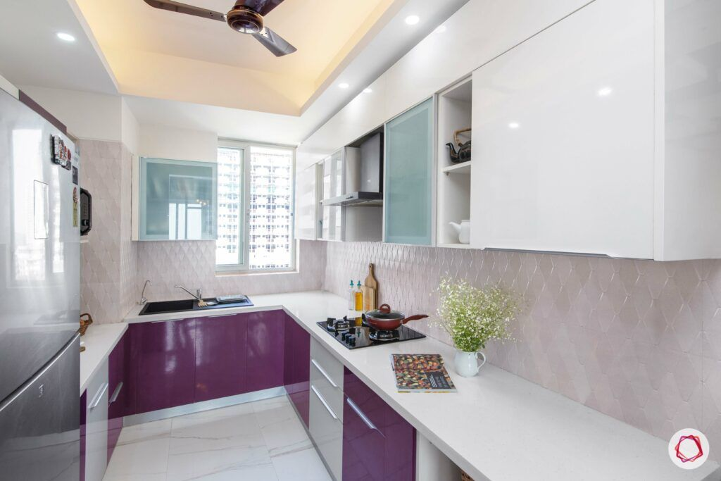 how to make a kitchen look brighter-recessed lights-purple cabinets-white cabinets