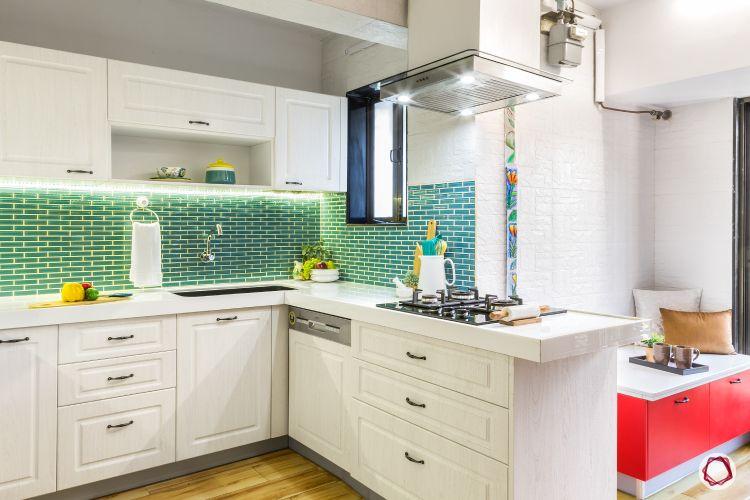 how to make a kitchen look brighter-task lights-blue backsplash-chimney lights