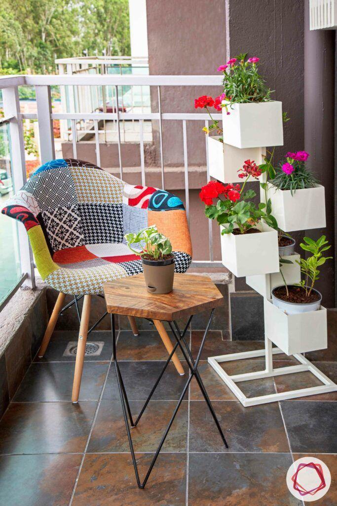 small balcony design-white vertical planter designs-colourful chair designs