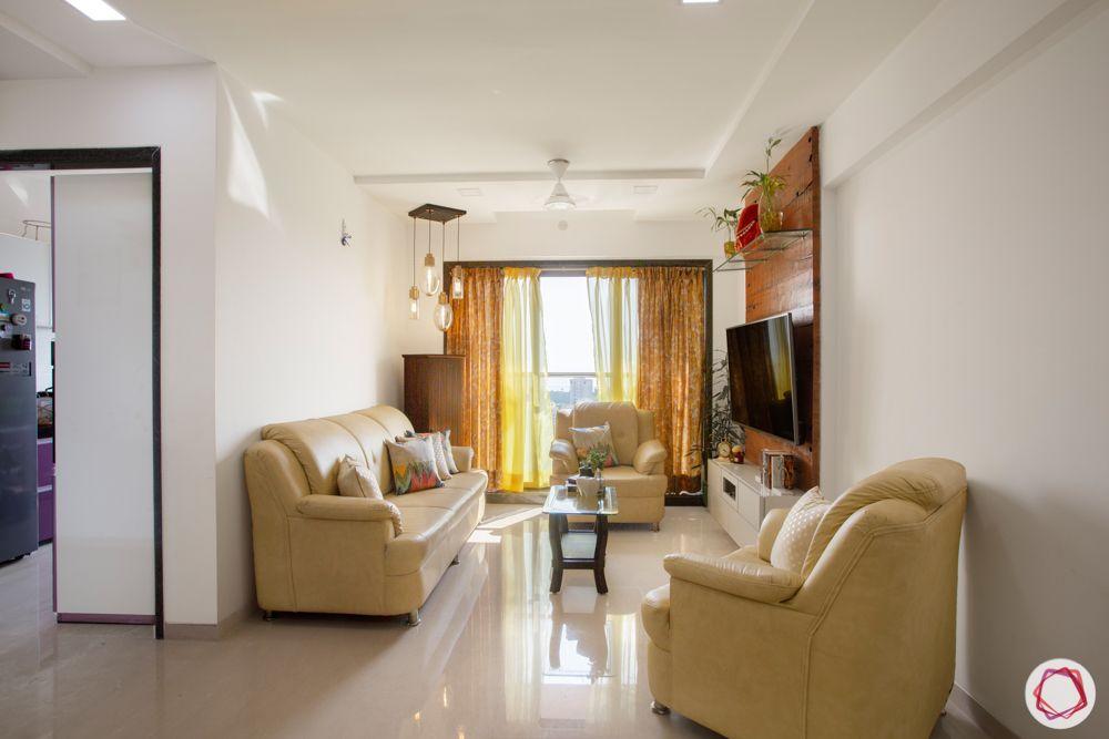 2-bhk-in-mumbai-living-room-leatherette sofas-beige sofas