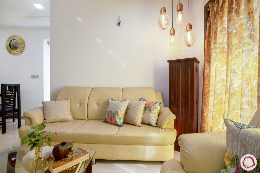 2-bhk-in-mumbai-living room-storage unit-corner lights