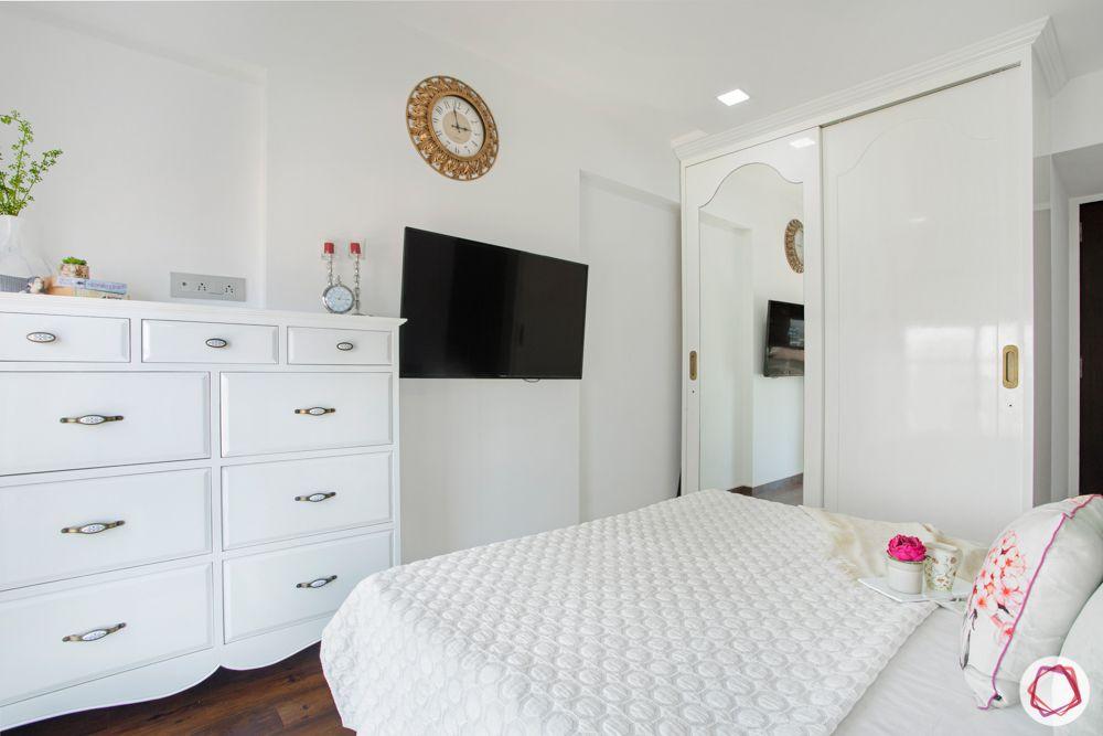 2-bhk-in-mumbai-master bedroom-white sliding wardrobes-mirror shutter