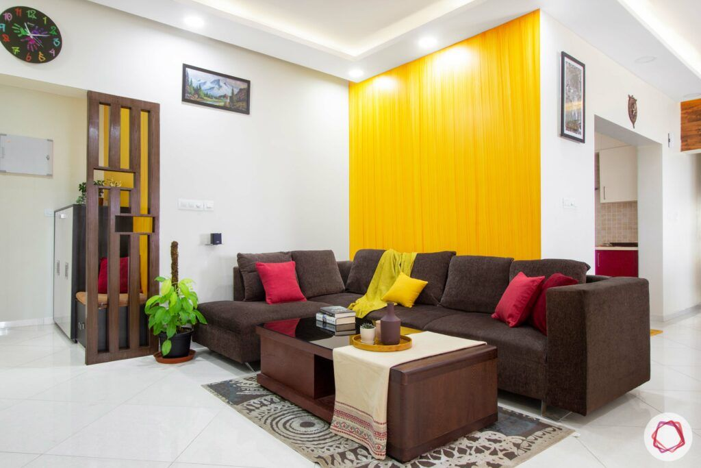 living-room-yellow-orange-textured-wall-sofa-pillows