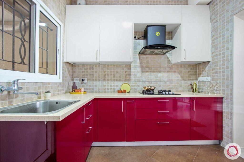 livspace-bangalore-red-cabinet-kitchen-corian-countertop