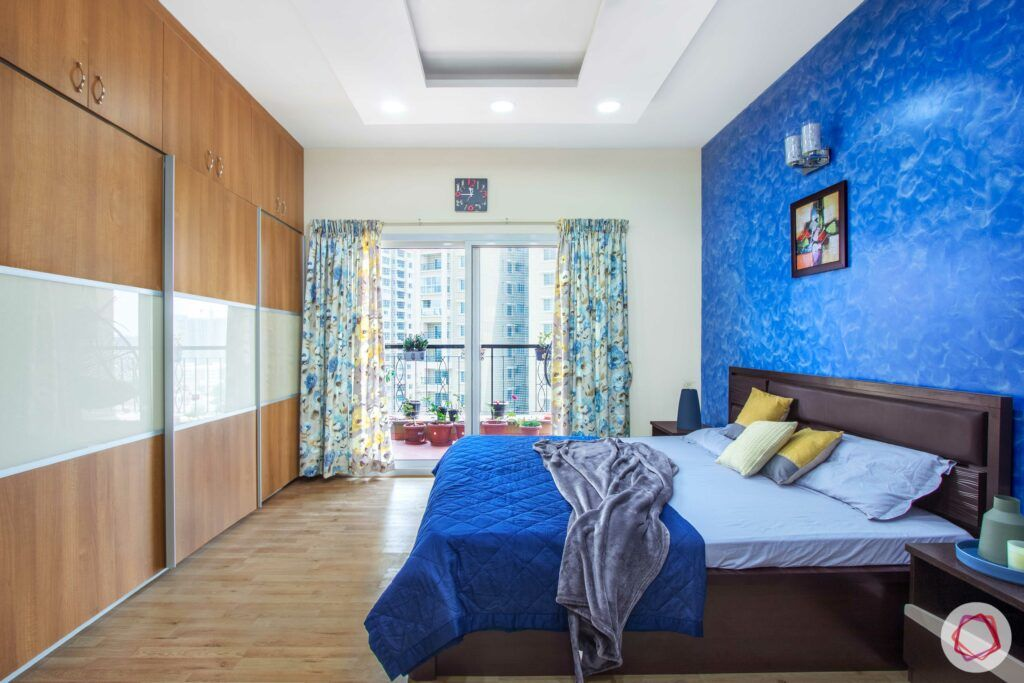livspace-bangalore-master-bedroom-wardrobe-blue-wall-wardrobe