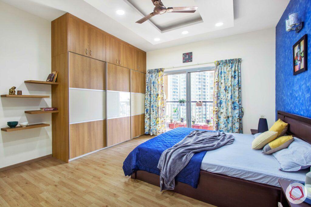 livspace-bangalore-master-bedroom-wardrobe-laminate-lacquered-glass