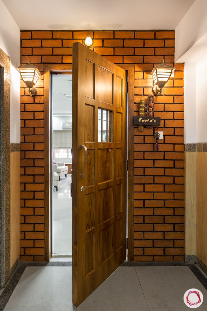 ajmera-exposed brick wall designs-front door designs