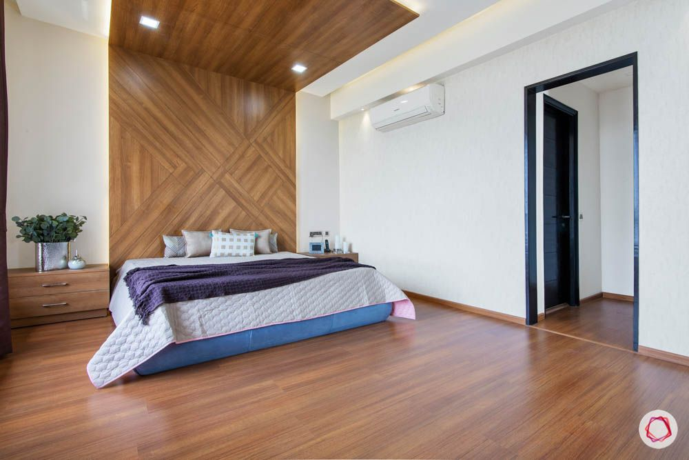 laminate vs veneer-laminate flooring-bedroom-bed panel