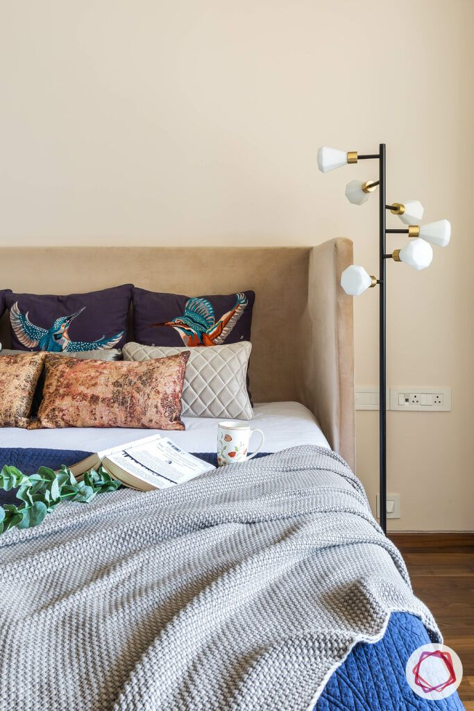 floor-lamp-bed-headboard-coffee-table-pillows