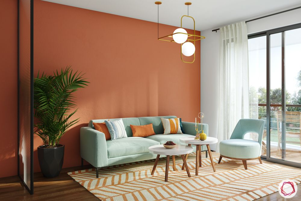 orange wall colour-blue couch designs