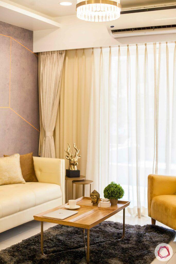 2bhk pune-brown rug-chandelier