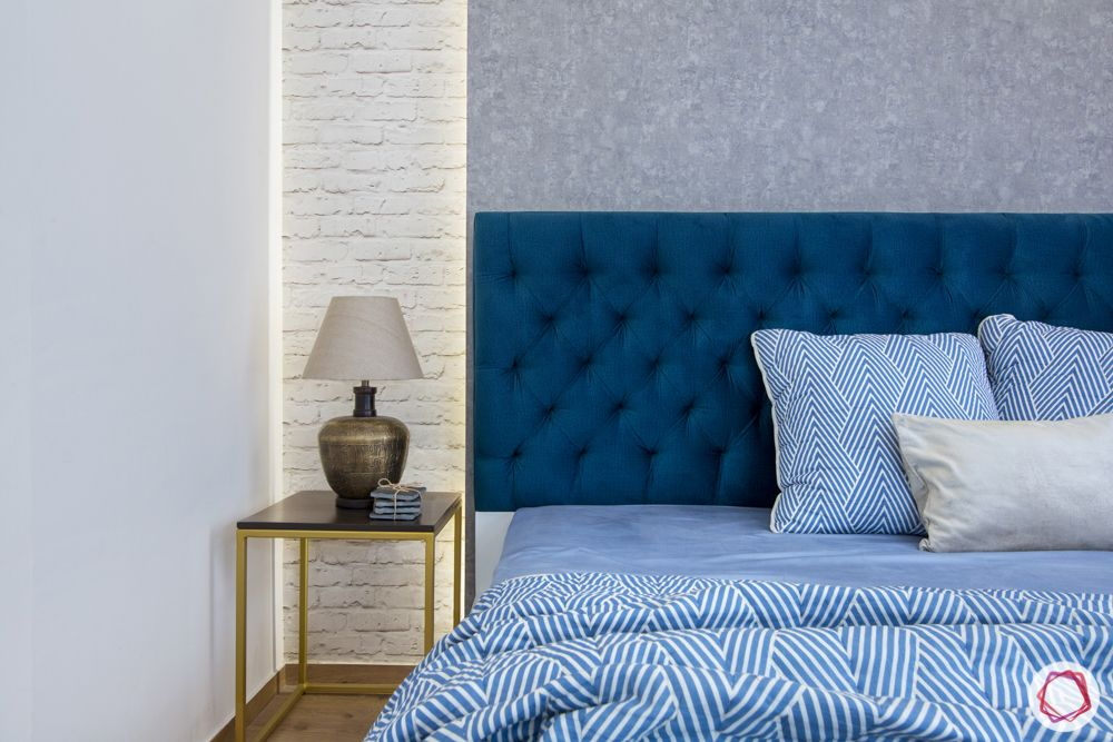 blue headboard-side table-white brick wallpaper