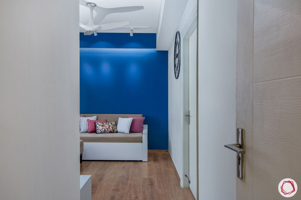 blue wall-lounge-cushions-white door