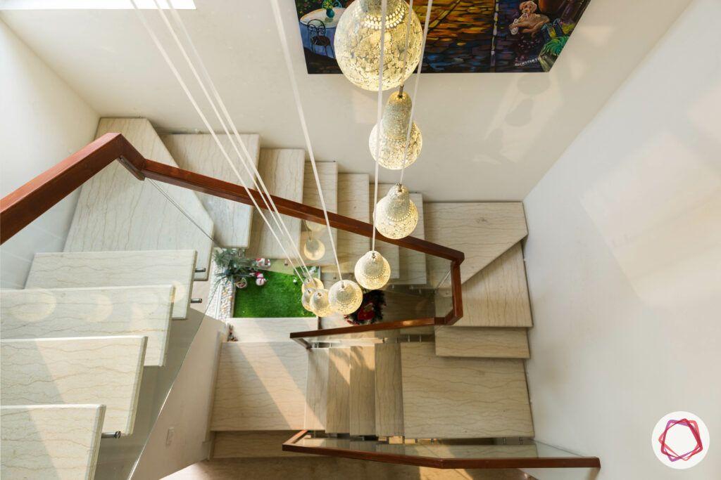 stair railing design-spiral railing-chandelier-wooden railing