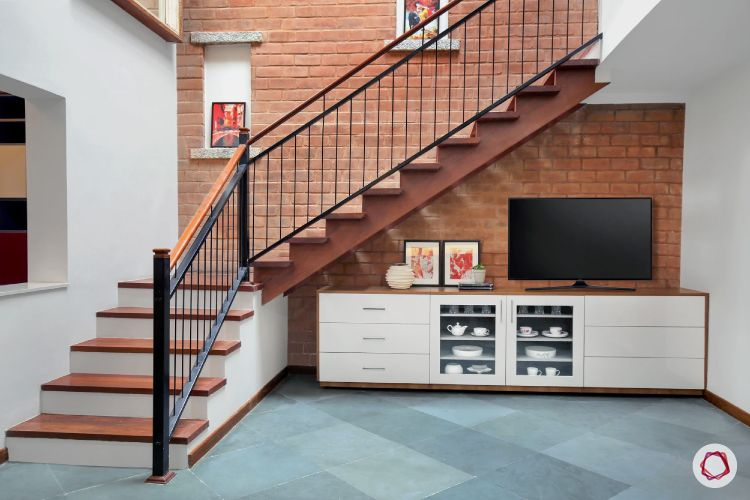 tv unit-crockery unit-under stairs-exposed brick wall