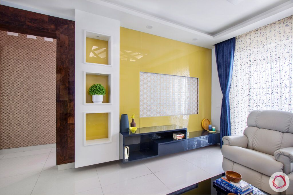 snn-raj-grandeur-living room-tv unit-yellow tv unit
