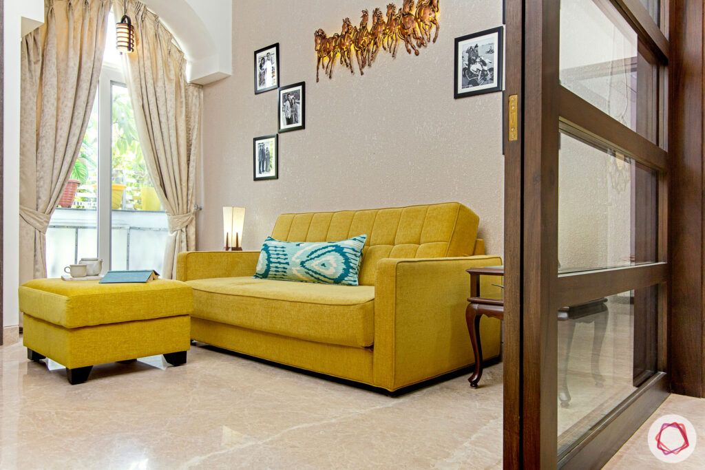 family-room-living-yellow-sofa-cum-bed-textured-paint