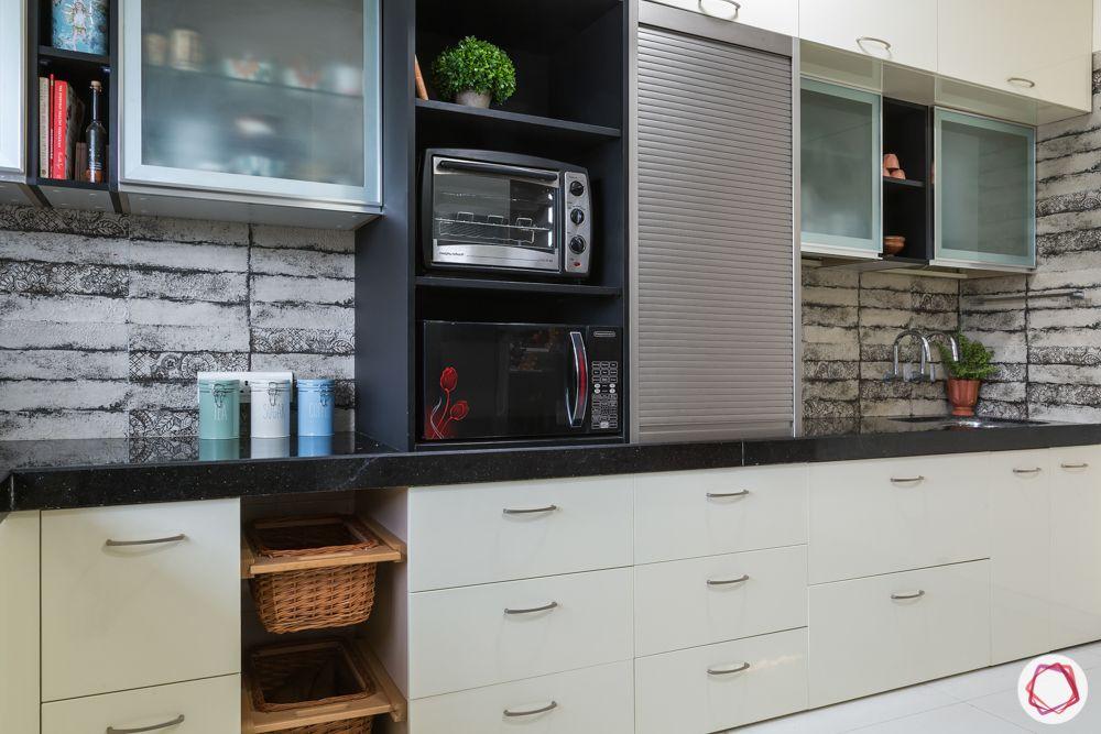 house kitchen design-open unit-tambol unit-beige backsplash-wicker baskets