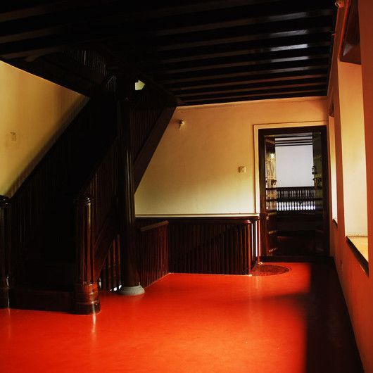 red oxide flooring-wooden staircase