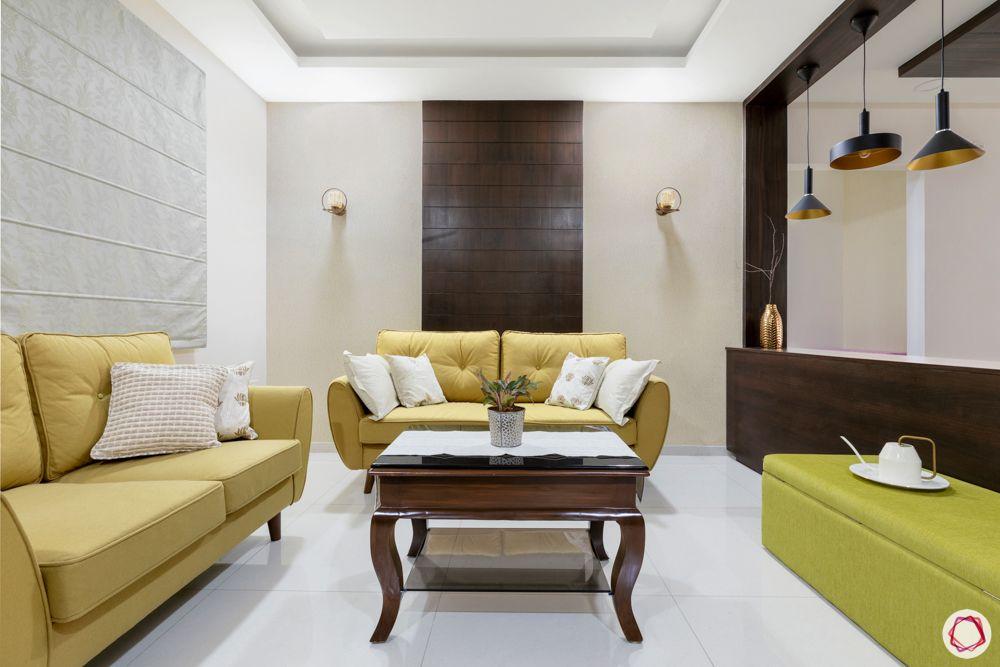 rajapushpa atria-yellow sofa designs-green ottoman designs