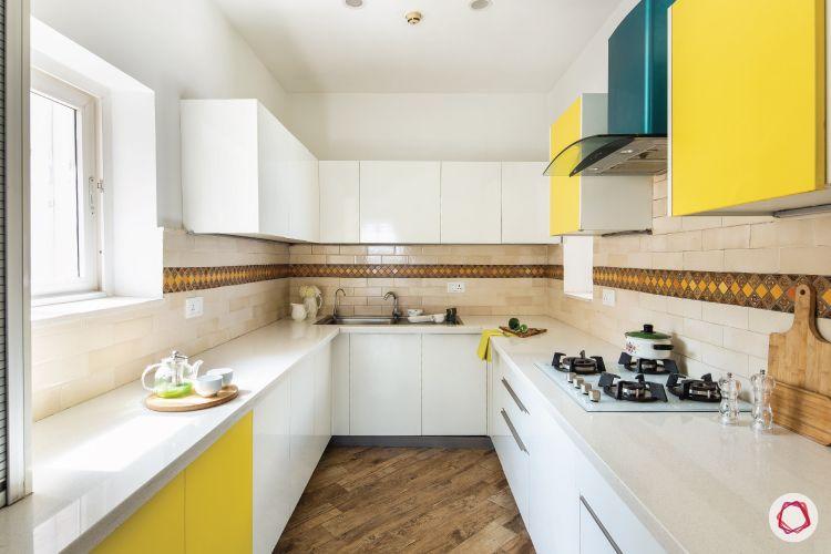 types-of-flooring-laminate-yellow-white-kitchen
