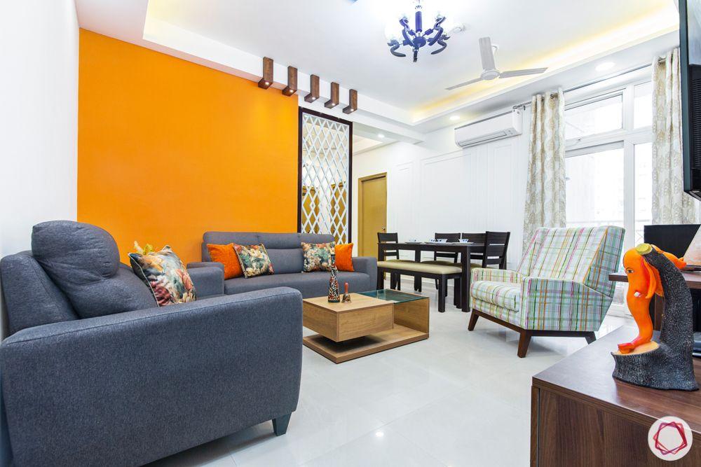 mahagun mywoods-livspace noida-living room-orange wall