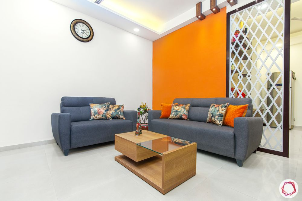 mahagun mywoods-livspace noida-living room-grey sofa-orange wall
