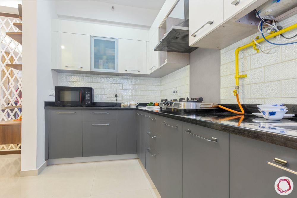 mahagun mywoods-livspace noida-grey kitchen cabinets-backsplash tiles