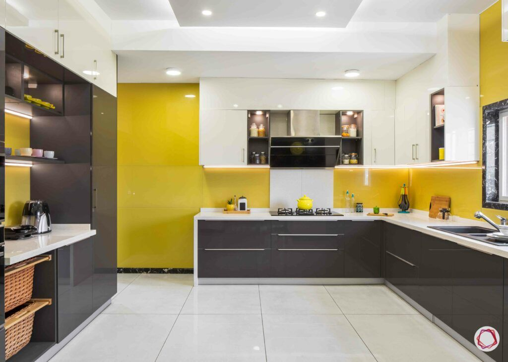modular kitchen design images-yellow lacquered glass-wicker basket-drawer handles