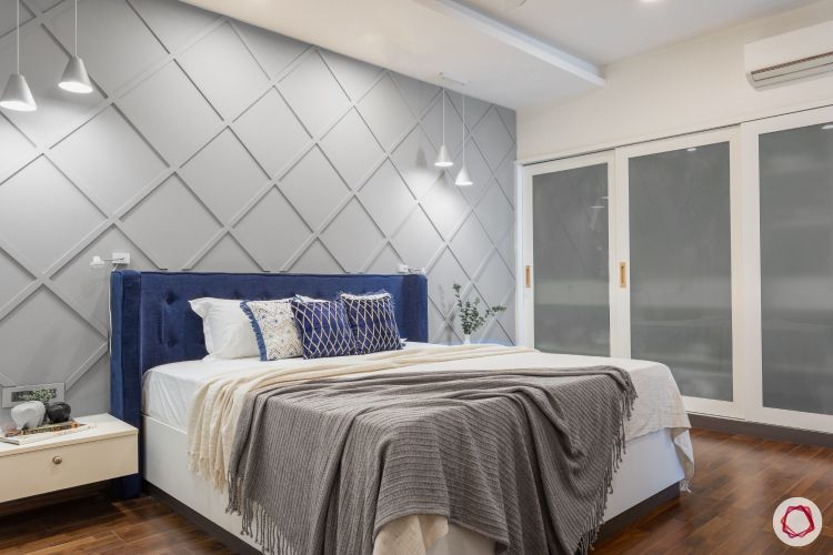 interior design styles-contemporary bedroom-pendant lights-blue headboard-grey accent wall