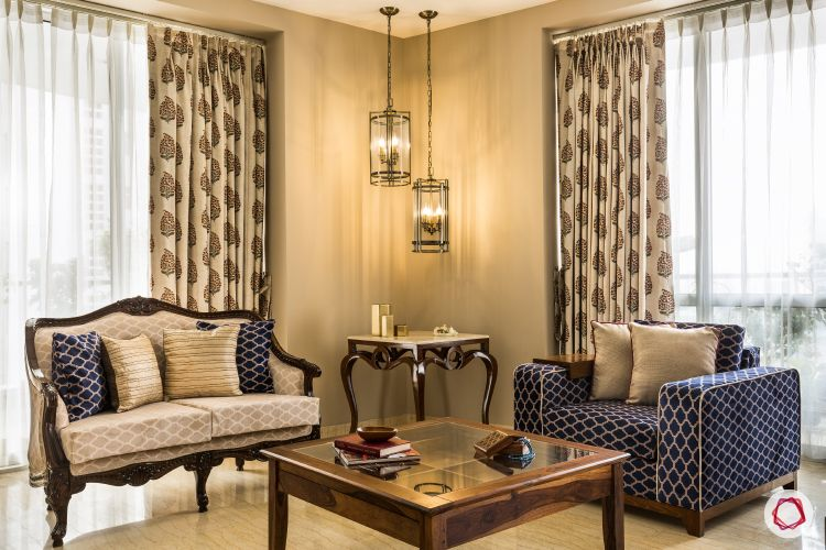 interior design styles-vintage living room-couches-curtains-pendant lights