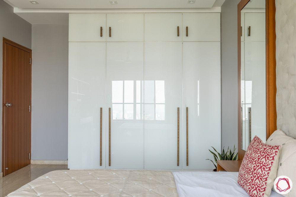 white wardrobe design-glossy hinged door-metallic handles