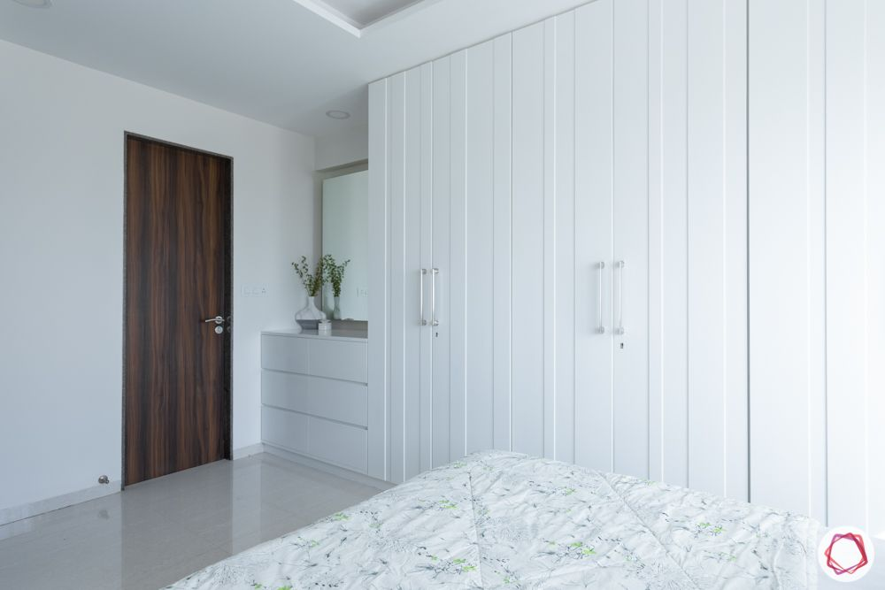 white wardrobe design-panelled doors-white bedroom