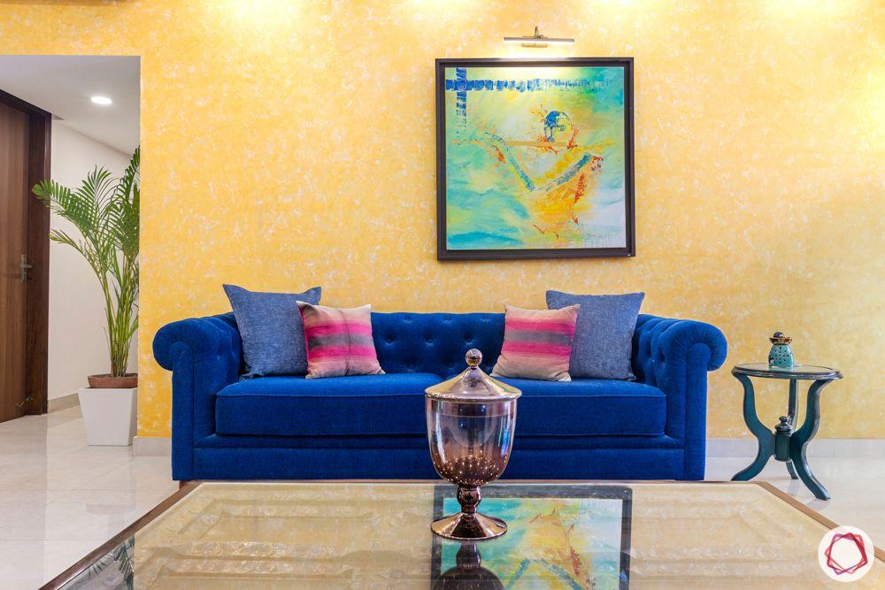 jal vayu vihar-yellow wall-blue sofa-side table