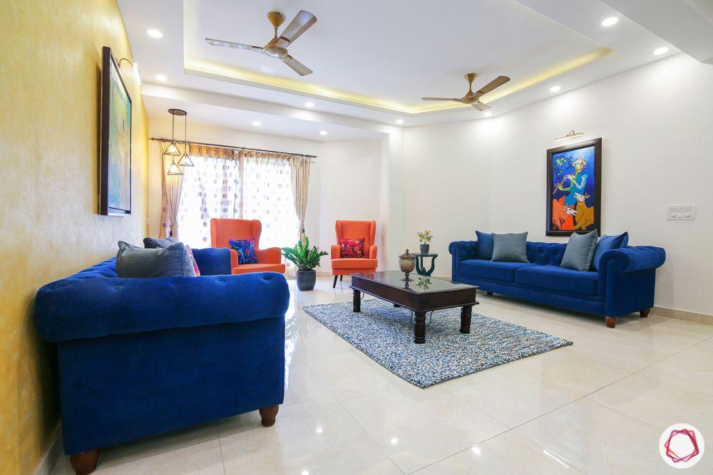jal vayu vihar-pendant lights-blue sofa-wall art