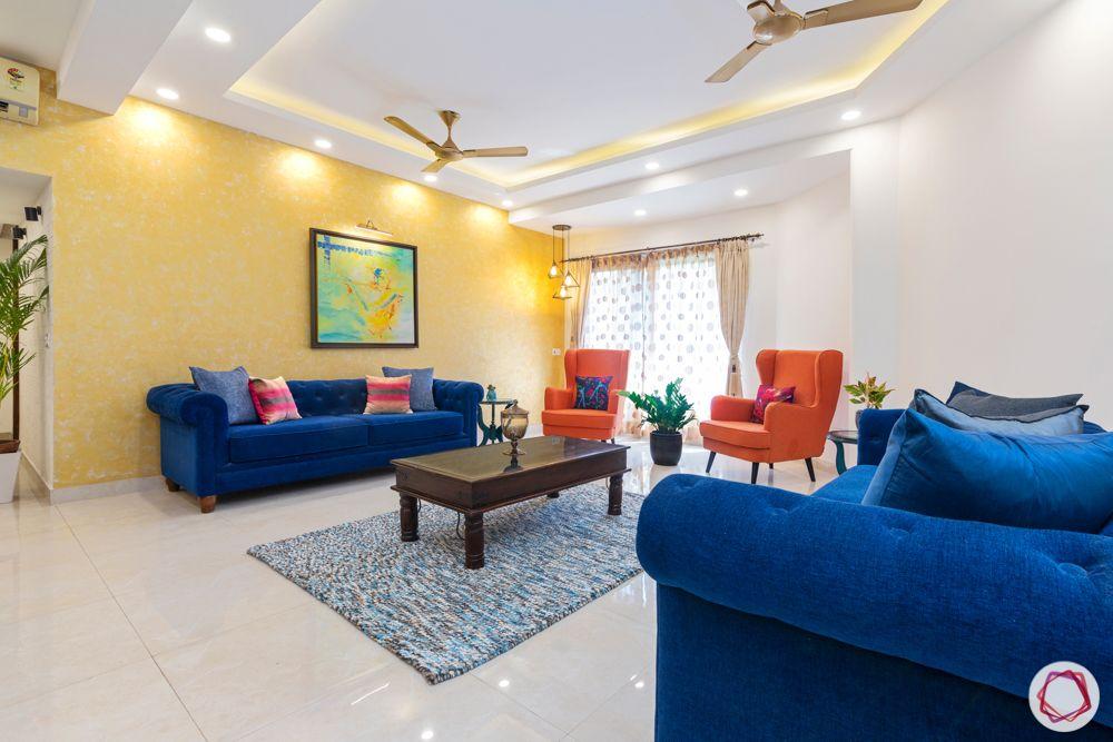 jal vayu vihar-yellow textured paint-blue sofa