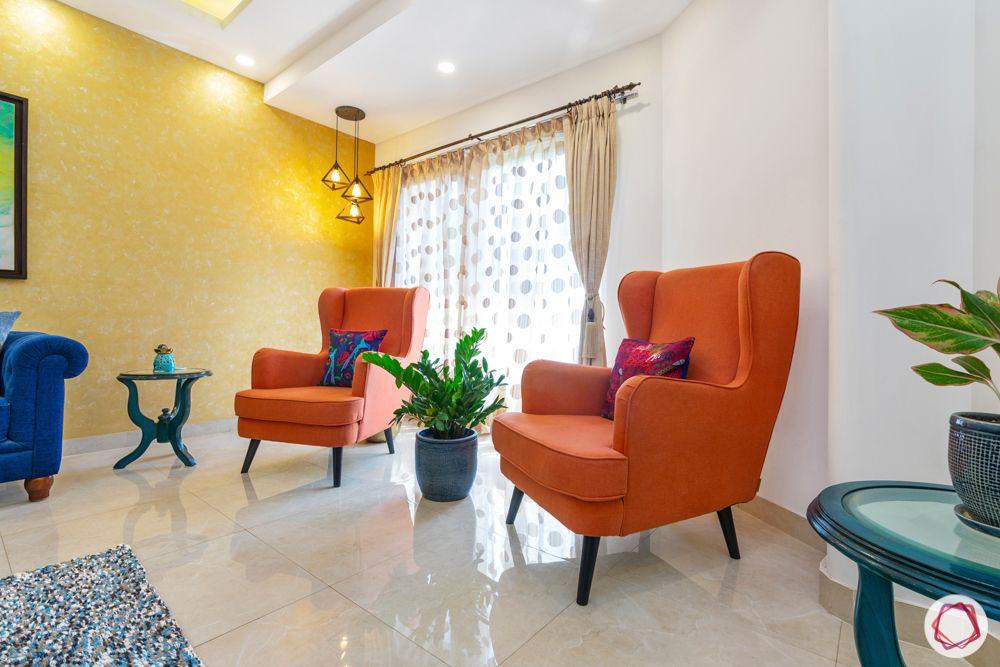 jal vayu vihar-orange winged chair-pendant lights