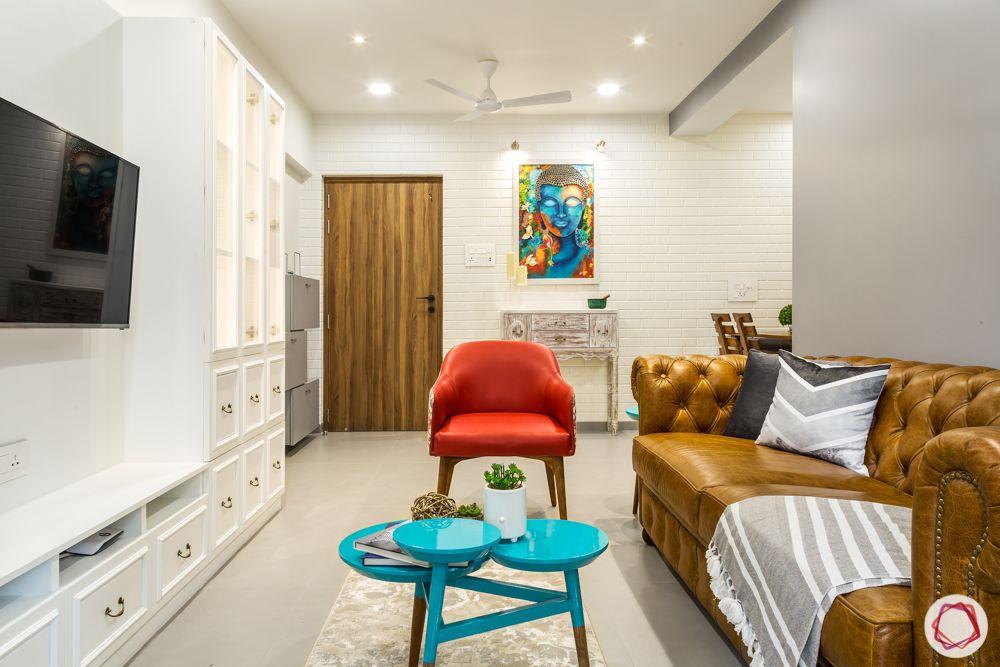 Interiors-in-Mumbai-sofas-door-red-armchair