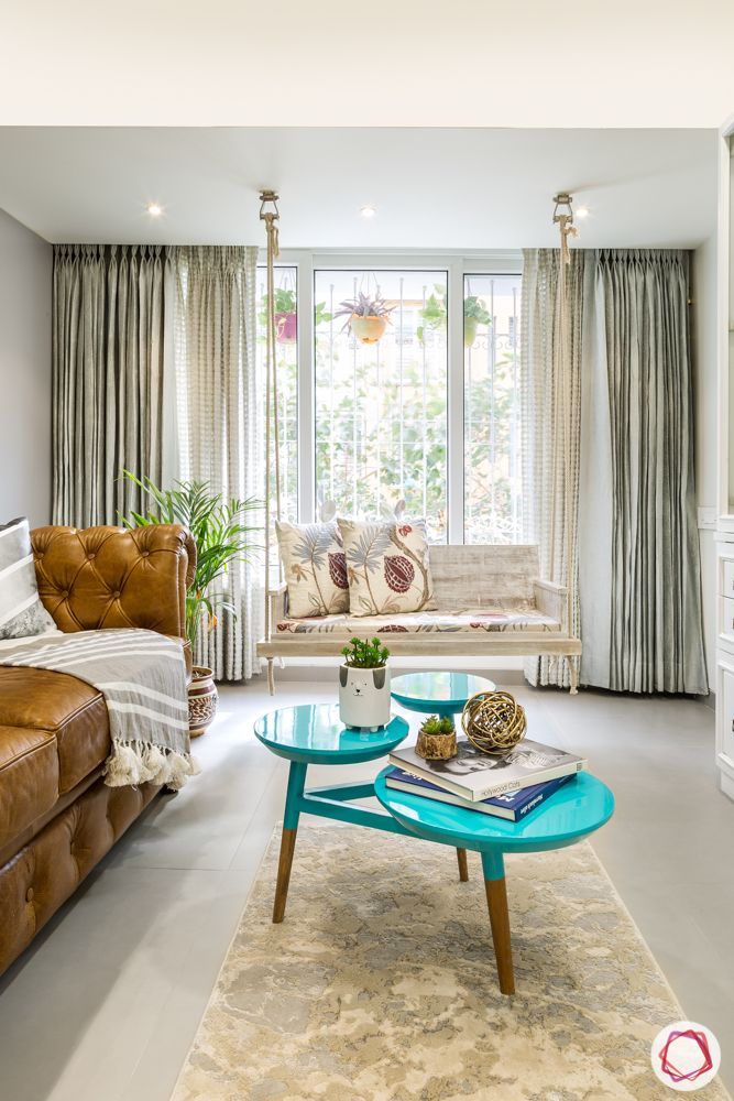 Interiors-in-Mumbai-living-room-coffee-table-swing-white