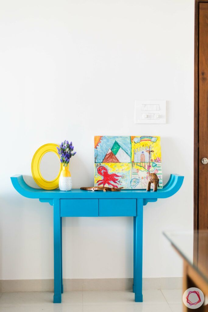 how to style a console table-blue-flower-vase-painting-artefacts