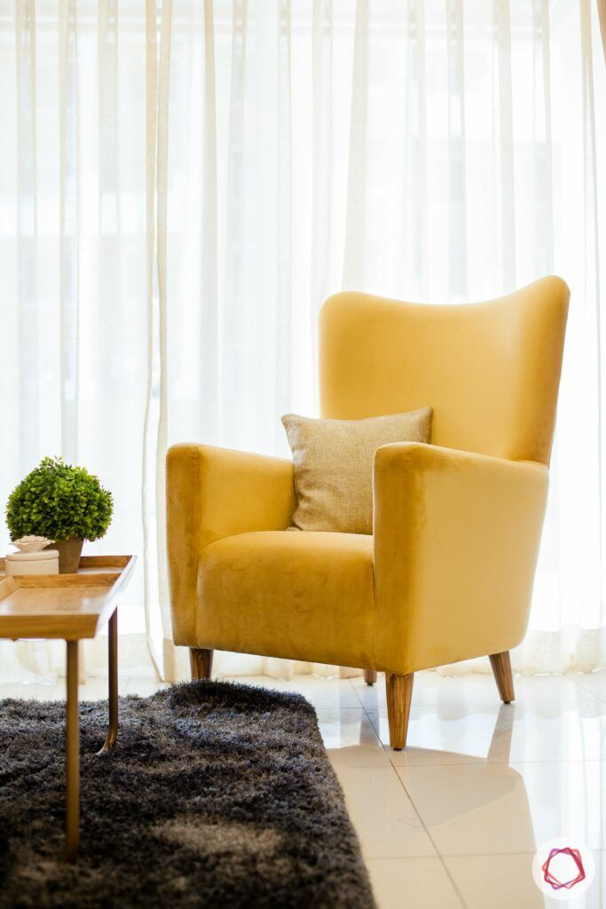 bookshelf-yellow-chair-window