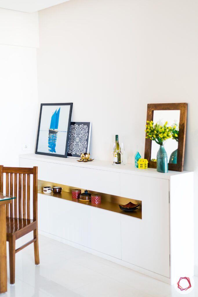 white console designs-sleek console-niche-paintings-plants