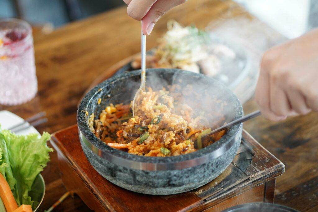 cookware-material-stone pan-food-steam-spoon-fork