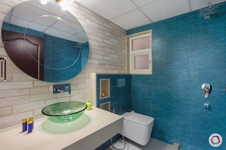 bathroom-blue-wall-circle-mirror-glass-sink-white-sink
