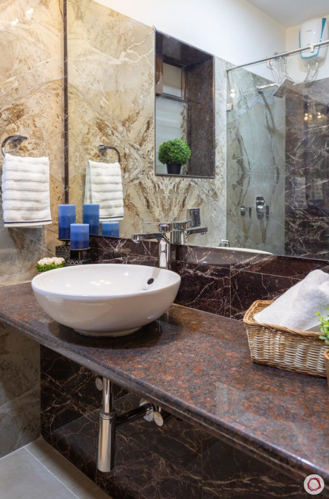 bathroom-rust-like-counter-white-sink-basket-towel