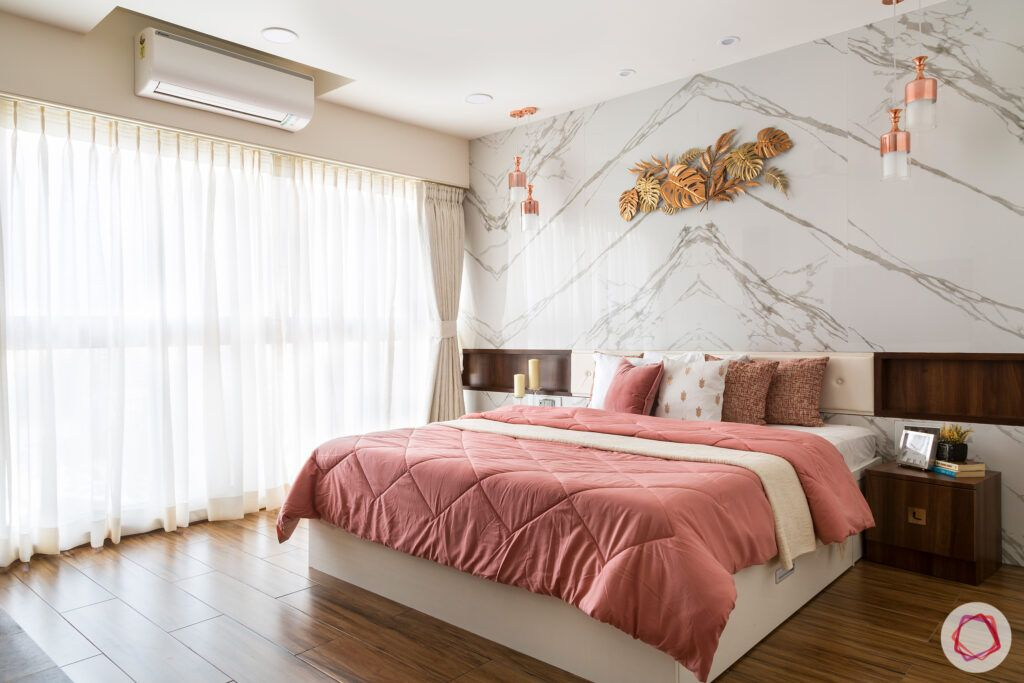 modern bedroom designs-marble accent wall-contemporary bedroom-wooden flooring-bedside alcoves